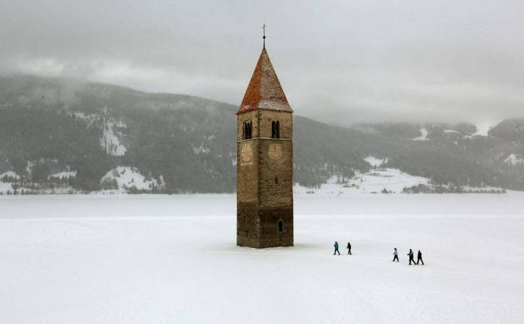 Abandoned-Places-From-Around-The-World-7-Church-steeple-in-the-middle-of-a-frozen-lake-Reschen-Italy