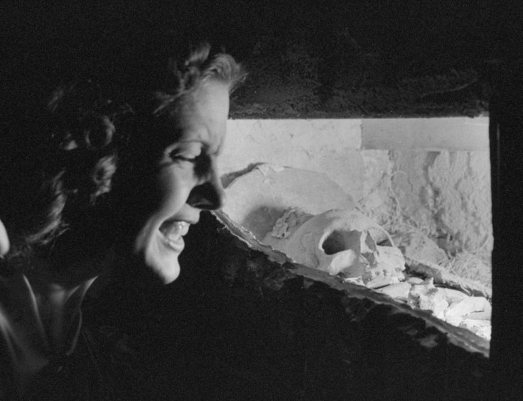 A woman looking at a plaster skull in the Catacombs Nightclub.  (Photo by Ralph Morse/Pix Inc./The LIFE Images Collection/Getty Images)