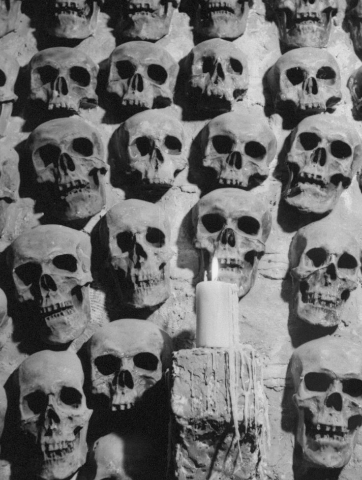 A candle lighting the room filled with plaster skulls at the Catacombs Nightclub.  (Photo by Ralph Morse/Pix Inc./The LIFE Images Collection/Getty Images)